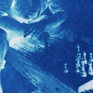 Image of a prisoner playing chess