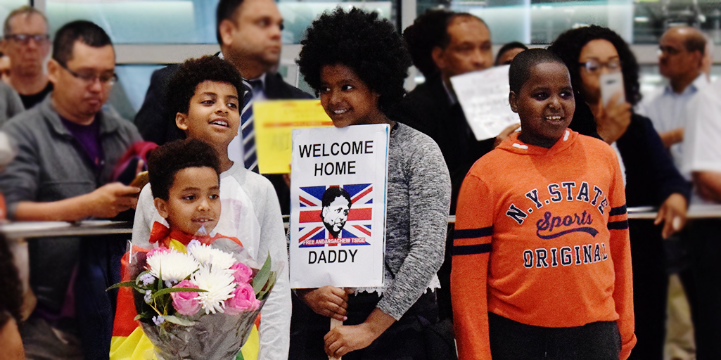 Image of Andy's children waiting for him at Heathrow