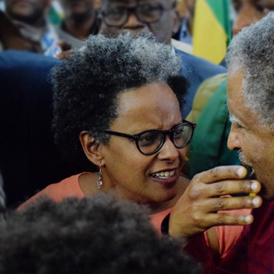 Image of Yemi and Andy Tsege reuniting at Heathrow airport
