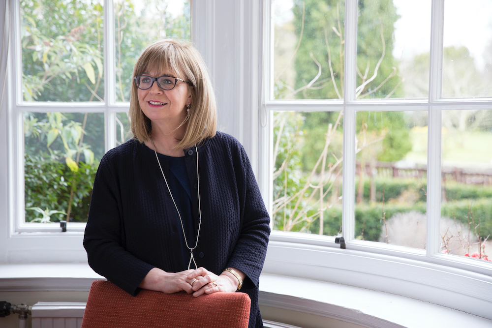 Image of Dame Elish Angiolini  in front of window